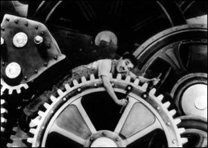 """Uma das cenas do filme """"Tempos Modernos"""" sobre a Revolução Industrial."""