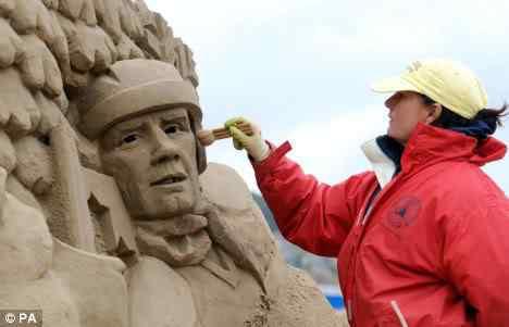 sandscu3 Incríveis esculturas de areia