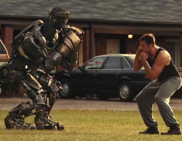 Hugh Jackman with star robot Atom in Real Steel 1 624x483 Os melhores filmes do mundo com robôs