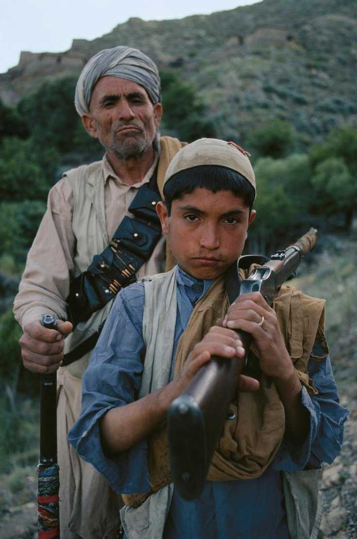 Father and son fighting against the government, Kunar, Afghanistan, 1980