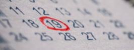 Calendário com data circulada em vermelho