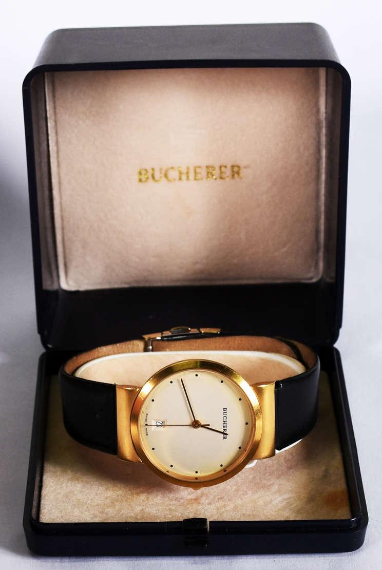 b75c5690205 Relógio marca Bucherer com ... - Relógio marca Bucherer com calendário e  pulseira de