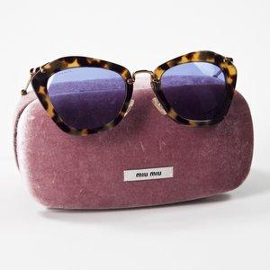 Óculos Miu Miu armaçao tartaruga
