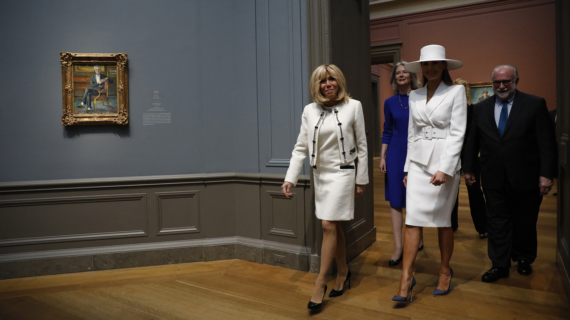 WASHINGTON, DC - April 24: First Lady Melania Trump and French first lady Brigitte Macron tour the National Gallery of Art on April 24, 2018 in Washington, DC. President Donald Trump is hosting French President Emmanuel Macron for the first state visit of his presidency. Aaron P. Bernstein/Getty Images/AFP