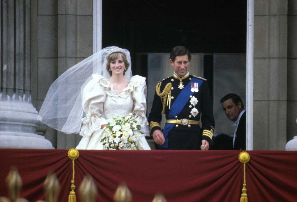 Prince Charles & Princess Diana (1961 - 1997) stand on the balcony of Buckingham Palace after their wedding ceremony at St. Paul