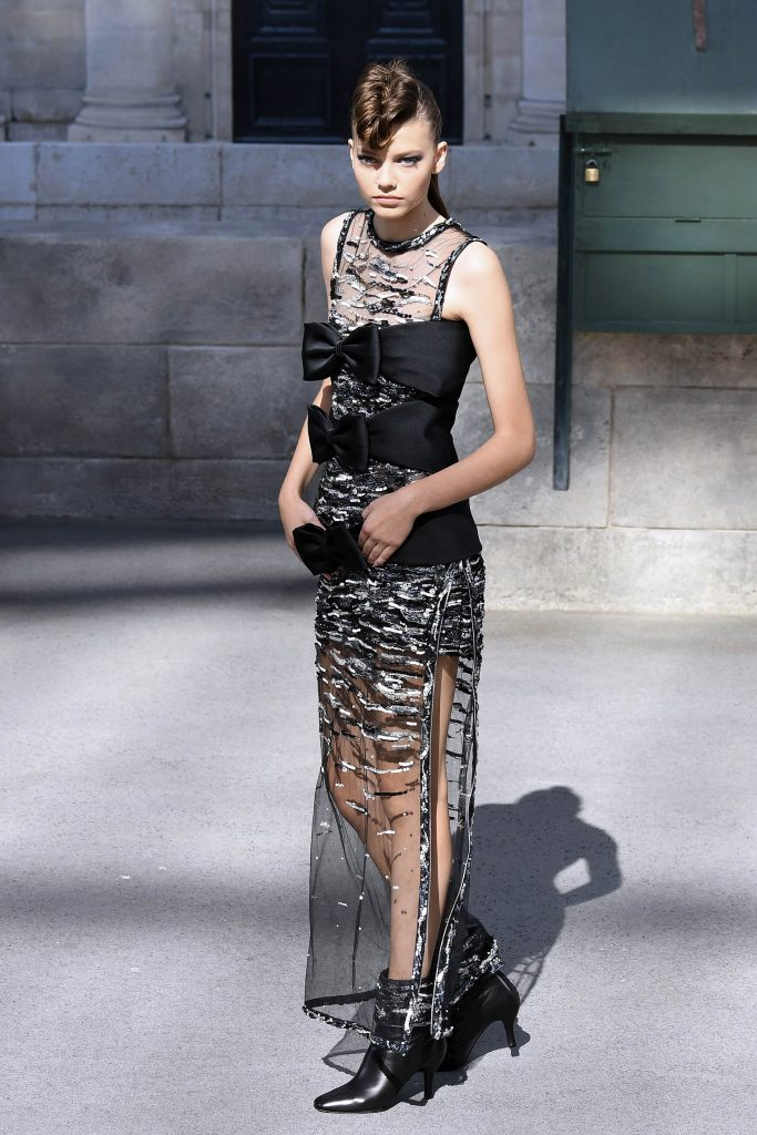 A model presents a creation by Chanel during the 2018-2019 Fall/Winter Haute Couture collection fashion show at the Grand Palais in Paris, on July 3, 2018. For the 2018-2019 Fall/Winter Haute Couture collection, Chanel brings a replica of the French Institute (Institut de France) and French capital
