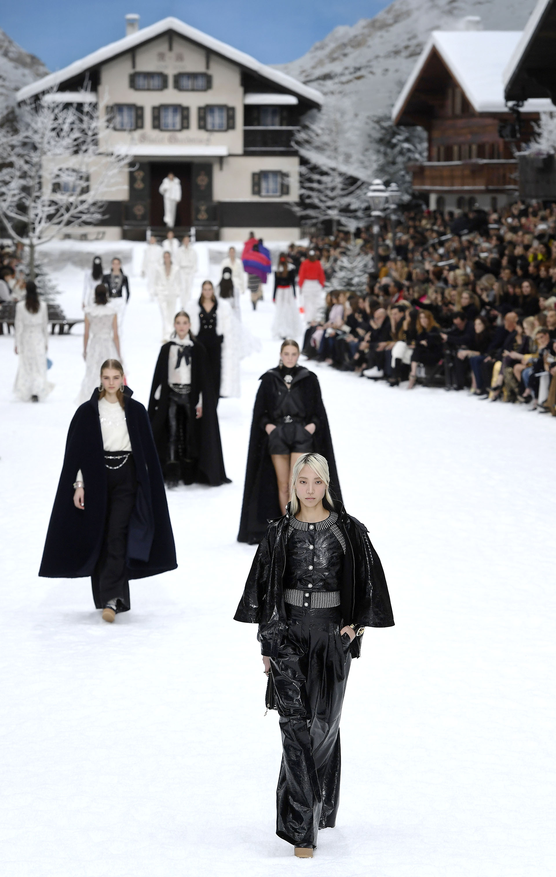 Models present creations by Chanel during the Women