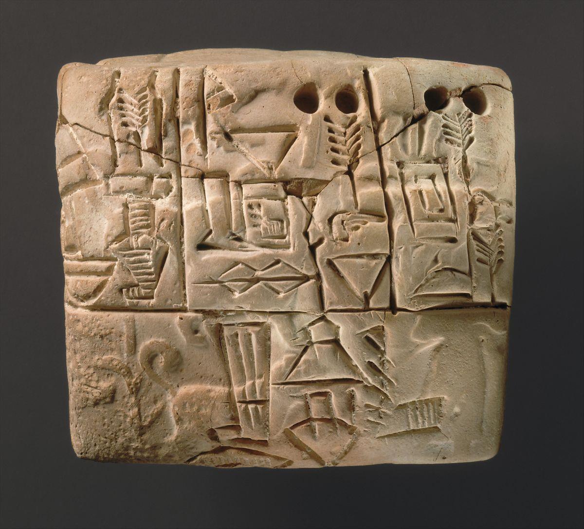 Tábua de argila com escrita cuneiforme.