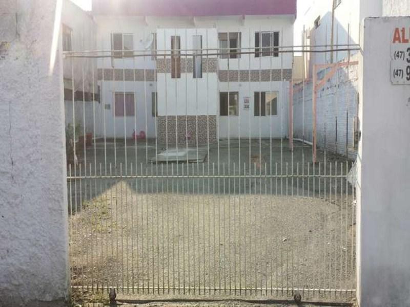 Prédio com 4 apartamentos para alugar, Terreno com potencial construtivo, a venda em Camboriú!