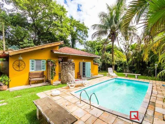 Casa com 4 dormitórios (3 suítes) à venda em Caraguatatuba, no bairro Portal Do Tabatinga