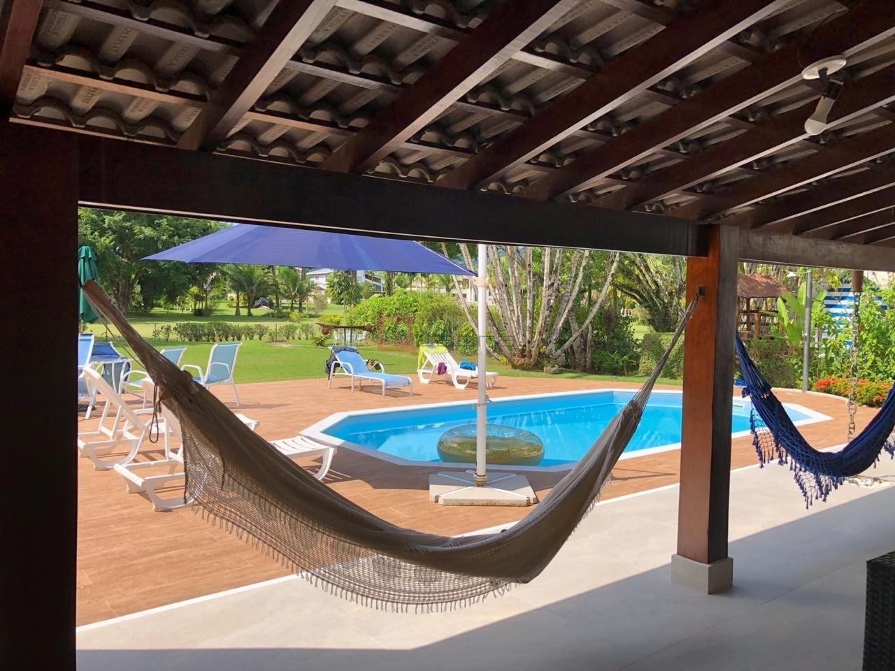 Casa com 4 dormitórios (3 suítes) para temporada em Caraguatatuba, no bairro Tabatinga