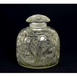 RENÉ LALIQUE, Frasco perfumeiro de vidro artístico, intitulado Epines. Alt. 9,5 cm. França circa 1920