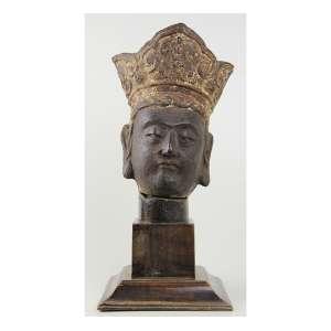 Estatueta de bronze representando Cabeça de Buda. Alt. 30 x 20 x 18 (bronze) e 43 x 20 x 20 (com base) Ásia século XVIII.