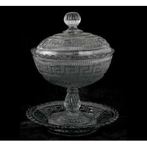 Compoteira de cristal com respectivo presentoir, ornamentado com gregas em sua lateral. Alt. 24 x 19cm. (c/ pequeno bicado) Europa Início século XX.