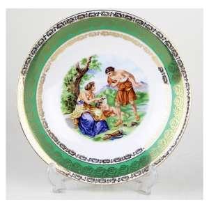 Prato de porcelana decorado com cena clássica em sua reserva central, borda com fina douração Diam. 23cm. Alemanha, início séc. XX