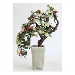 Ornamento de porcelana celadon com folhagens de pedras diversas, representando floreiro e bonsai. Alt. 32 x 22 x 09cm. China, séc. XX