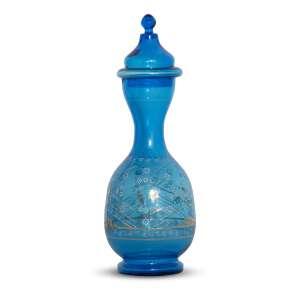 AUTOR NÃO IDENTIFICADO - Vaso<br>vidro azul decorado em motivos florais dourados<br>Procedência: Laetítia Cruz de Moraes Vasconcellos<br>39 x 12 cm