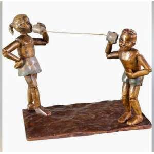 "VÂNIA BRAGA - ""Mémória da infância – telefone de lata"", escultura em bronze, 37 x 32 x 24, assinada."