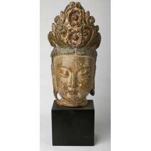 Cabeza china dinastia Tang en madera policromada. 50 cm de alto.