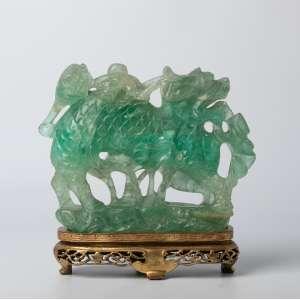 Talla china en raíz de esmeralda siglo XIX. Medidas: 17 x 21 cm