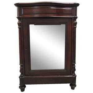 Dunquerque estilo Império, em jacarandá e em madeira nobre entalhada, com uma gaveta sobre uma banda de porta com espelho. Tampo com mármore. Med. 96x67x39 cm.
