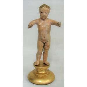 Menino Deus - imagem do Séc. XIX, em madeira policromada. Olhos de vidro. Base em madeira dourada. Alt. total 29,5cm.