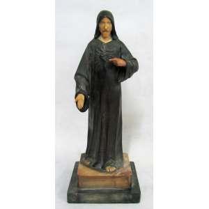 Escultura francesa em bronze e marfim, representando Sagrado Coração de Jesus. Base de mármore em degraus. Alt. total 33cm.