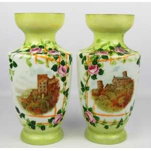 Par de vasos em opalina europeia, policromada e decorada com pintura de paisagem com castelo e flores. Um com pequeno bicado na borda. Alt. 26,5 cm.