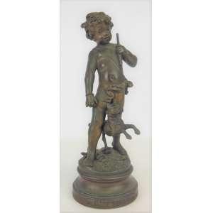 Auguste Moreau - Escultura francesa em bronze, representando Menino com cão. Alt. 23,5cm. Artista citado em diversos livros e de cotação internacional.