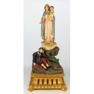 A. A. Estrella - Belíssima imagem portuguesa em madeira policromada, representando Nossa Senhora da Penha. Nossa senhora e menino com alhos de vidro. Peanha dourada com placa de identificação do escultor. Alt. 40 cm.