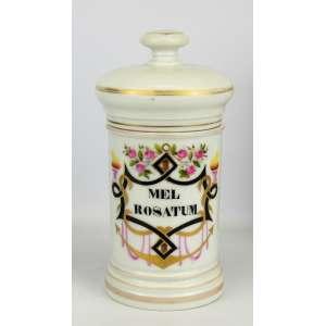 Belo pote de farmácia de coleção, em porcelana Vieux Paris, do Séc. XIX, decorado com pinturas policromadas e detalhes em dourado, tendo em reserva o nome da droga MEL ROSATUM. Alt. 25,5cm.