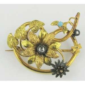 Antigo e belo broche em ouro 18k em ouro fosco e brilhoso, na forma de flor e folhas, com brilhante e pedra azul. Med. 4x5cm. Peso 15g.