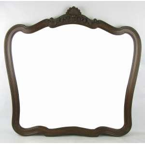 Espelho bisotado com moldura em jacarandá entalhado, com florão no ápice. Med. 80x86cm.