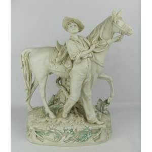 Grande grupo escultórico em biscuit Royal Dux - Bohemia, representando Jovem com seu cavalo. Marca da manufatura na base. Med. 39x31x18 cm.