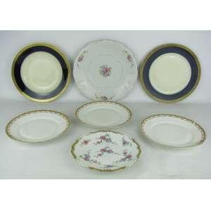 Sete pratos decorativos de diversas procedências e decorações, sendo três de Limoges, dois Rosenthal, um KPM e um alemão. Diam. maior e menor 26 e 20 cm.