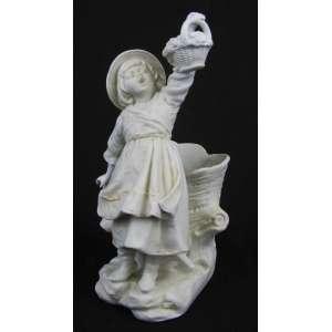 Floreira em biscuit europeu, na cor branca, adornada com figura de menina sustentando cesta com flores, com restauro. Med. 15x6,5x9cm.