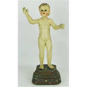 Menino Deus - Imagem europeia do sec. XIX, em madeira policromada. Base em madeira. Olhos de vidro. Alt. 28 cm.