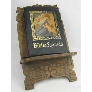 Porta bíblias de fechar em madeira entalhada em folhas e volutas. Acompanha a bíblia. Med. porta bíblia aberta 30x26m5x31 cm