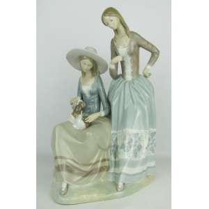 Lladró - Belo e grande grupo escultórico em porcelana espanhola em policromia, representando Passeio com cão. Med. 40x27x20 cm.