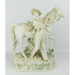 Raro e antigo grupo escultórico em biscuit Royal Dux - Bohemia, representando Jovem com cavalo, sendo este adornado com floreira. Marca da manufatura na base. Med. 39x31x18 cm.