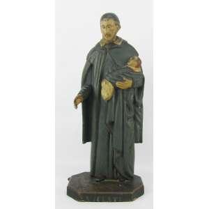 São Vicente de Paula - Imagem do Séc. XIX, em madeira entalhada e policromada. Alt. 41cm.
