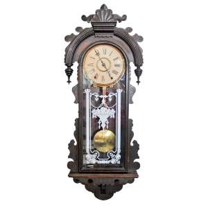 ANSONIA CLOCK COMPANY- QUEEN ISABELLA- N.Y. - U.S.A. 1904- Relógio de parede, com caixa em madeira entalhada. Porta com vidro original com gravação .(...) An uncommon model; for details see Tran Duy Ly's book on Ansonia (1998) page 191, figure 624. Med. 100x39x14 cm.