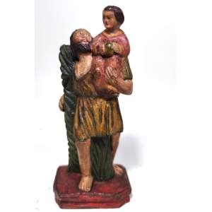 IMAGEM DE SÃO CRISTOVÃO- Minas Gerais, século XVIII. FATURA POPULAR,ESTE MENINO PARECE TER O PESO DO MUNDO, exclamou Cristóvão, um homem de grande compleição física que ajudava os peregrinos a atravessarem um rio. A BOLA-MUNDI, que o MENINO JESUS traz nas mãos é seu SÍMBOLO: SALVATORI MUNDI. Medidas:15x6x6 cm.
