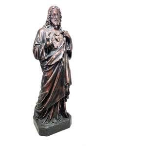 SAGRADO CORAÇÃO DE JESUS. <br />Escultura em petit bronze patinado. <br />Medidas: 60 x 18 x 15 cm.