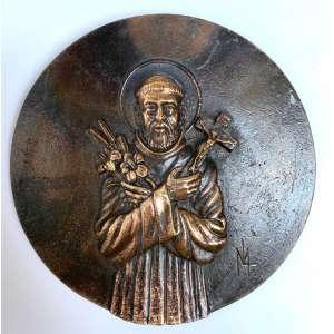 MIGUEL LANGONE - Medalhão em bronze, década de 1930, assinado pelo escultor italiano Miguel Langone - 14/04/1892<br />Placa em bronze circular com a imagem SÍMBOLO DA ORDEM FRANCISCANA: DOIS BRAÇOS CRUZADOS: OS LÍRIOS REPRESENTANDO A PUREZA E A CRUZ, REPRESENTANDO O CRISTO. Medidas: 18 cm de diâmetro.