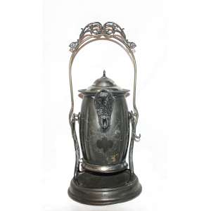 Chocolateira - Richfield plate U.S.A. (Cincinnati, Ohio,1847 - 1941). Com suporte e corta pingos. Medidas: 49x22x22 cm. Peso: 2,100 kg.<br />Marca: https://www.925-1000.com/silverplate_R.html