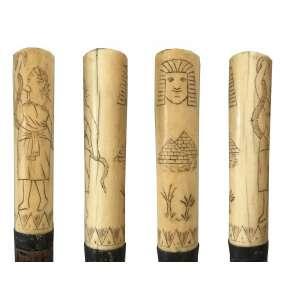 Bengala feita de madeira nobre , com detalhe de marfim com cenas Egípcias e mitológicas , Europa Séc. XIX Medidas Alt. 94 cm.