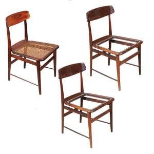 """SÉRGIO RODRIGUES - """"Lúcio Costa"""" - 3 cadeiras estrutura em madeira de lei maciça encerada, assento em palhinha e pés torneados. - 45 x 45 x 80 cm - (Duas falta palha no assento)."""