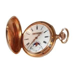 Relógio de bolso de ouro 18kl com 3 tampas apresenta mostrador de porcelana em excelente estado com fase da lua e triplo calendário apresenta na tampa marca FK e doura Suíça, peso total 107g - Europa - Séc. XIX.