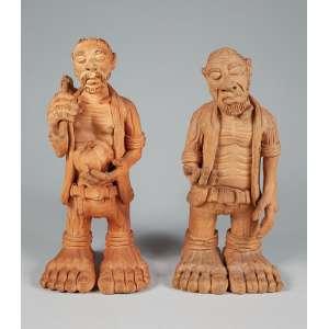 """JOSÉ ROBERTO DE FREITAS (BETO PEZÃO)<br />A) """"Homem colhendo abóbora"""" Escultura em cerâmica. Ass. loc. """"Aju -SE"""". 36 cm. altura. <br />B) """"Pedinte"""" Escultura em cerâmica. Assinada. 34 cm. altura."""